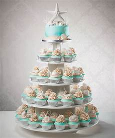 wedding cake and cupcake tower for a beach destination wedding in 2019 seashell wedding