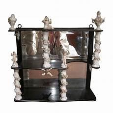 antique etagere shelf unit porcelain flowers and cherubs