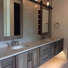 master bathroom mirror ideas master bath in hickory with morel stain cambria darlington featuring dura supreme floating