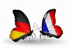 papillon en allemand deux papillons avec des drapeaux sur les ailes comme