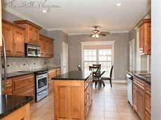 neutral grey walls medium and warm honey cabinets