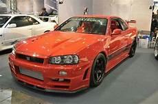 Orange Nissan Gt R R34 Nissan Skyline Nissan Gtr
