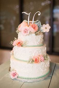 three tier vintage inspired wedding cake with intricate