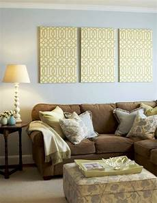 light blue walls light yellow accents and chocolate brown couch pretty but not sure if i