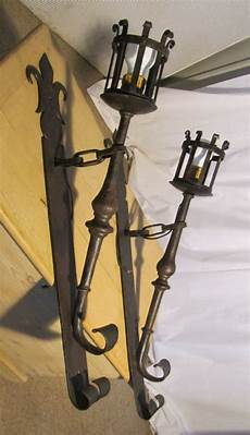 a superb pair of french gothic iron wall lights torches