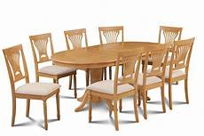 9 piece oval dining room table set w 8 soft padded chairs in oak finish dining sets