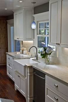 wall mounted light over kitchen sink subway tile with above interior lights symbol lighting