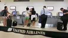 united raises second checked bag fee international flights abc news