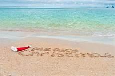merry christmas written tropical sand 169 jaysi 26653853