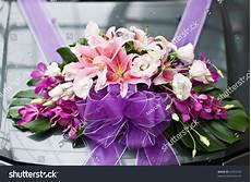 flower arrangement to a wedding car stock photo