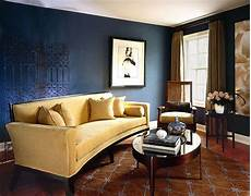 gold sofa brings a bright touch to this brown and blue interior brown and blue interior color