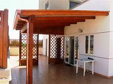 terrazzo in legno copertura a due falde con lucernari
