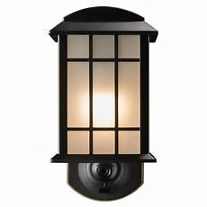 maximus 11 1 in h bronze motion activated dark sky medium base e 26 outdoor wall light at