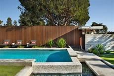 16 Stunning Mid Century Modern Swimming Pool Designs That