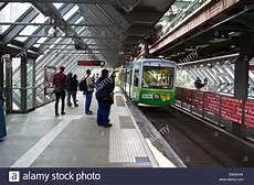 schwebebahn suspended railway arriving at a