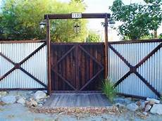 this creatively built corrugated metal fence features a