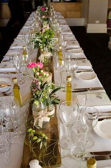 rustic plank table runner styling and flowers by