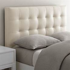 Unbuttoned Grid Tufted Headboard Geometric Detailing unbuttoned grid tufted headboard with geometric detailing