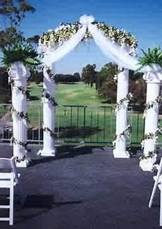 each column is surrounded with pre lit designer wedding decoration floral garlands with white