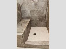 Carbon Gray Tiled Shower with Bench and White Square Tile