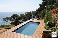 photo piscine hors sol avec terrasse bois autour attirant