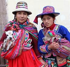 wearing traditional of a village hours outside of cusco charge tourists about