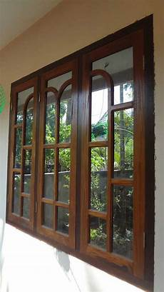 latest kerala wooden window door designs