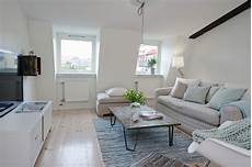 An Apartment Which Shows Us That White Walls Can Also Be Cozy an apartment which shows us that white walls can also be cozy
