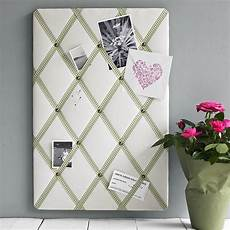 linen noticeboard by pins and ribbons