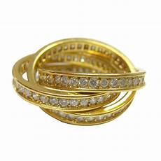 cartier yellow gold and diamond rolling ring jewelry