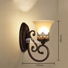 rustic wall sconces wrought iron glass shade contemporary carved