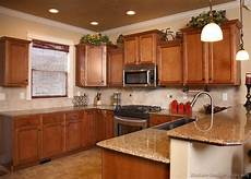 kitchens with a penninsula pictures of kitchens traditional medium wood cabinets golden