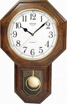 rhythm light wood pendulum wall clock model cmj443nr06 price review and buy in kuwait