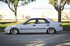 honda civic sedan on diamond racing wheels 15x8 with a