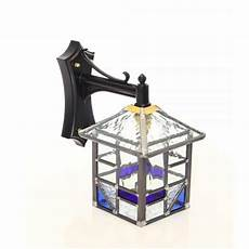 traditional outdoor wall lantern with blue and clear glass shade