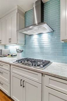 glass backsplashes for kitchens the reflective quality of this kitchen s blue glass tile