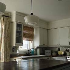 soffits painted the same color as the cabinets make the cabinets taller corbels enhance