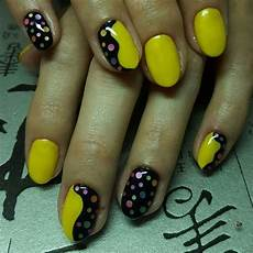 i love this nail design yellow and black with polka dots