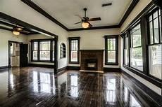 hardwood floors white walls brown trim yes this