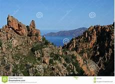 korsika meer und berge stockfoto bild wolke orange