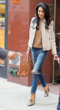 amal clooney style amal clooney wears distressed denim and leather instyle