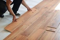 wood look on a budget luxury vinyl plank vs laminate