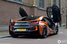 manhart s bmw i8 wrapped in orange and black spotted in