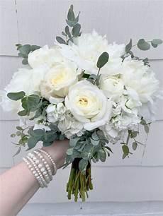 elegant white bridesmaid s bouquet composed of peonies