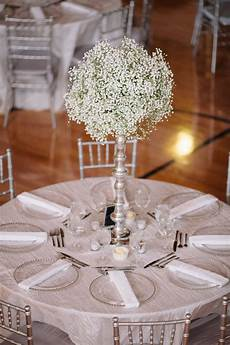 all silver and white wedding with grand baby s breath as the centerpiece simple and stunning at