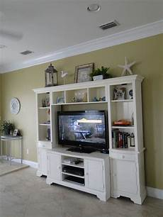 Decorating Ideas Top Of Entertainment Center by Decorating Tops Of Entertainment Centers