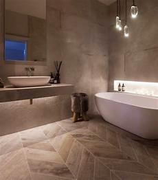 janey butler interiors luxury spa style bathroom design with herringbone wood concrete