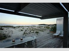 Beach House Made of Contrast Materials and Surrounded By