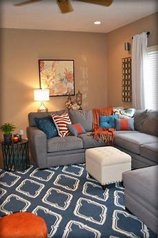 orange accents living room orange and blue living room colorful pillows are my favorite