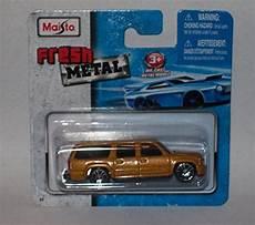 maisto fresh metal die cast vehicles 2001 chevrolet suburban gold buy online in uae